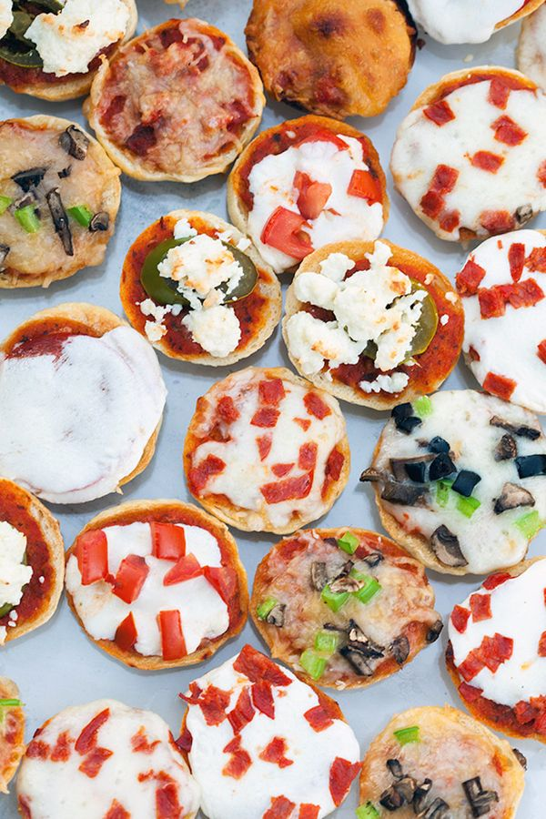 "<strong>Get the <a href=""http://www.spachethespatula.com/homemade-bagel-bites/"" target=""_blank"">Pizza Bagel Bites recipe</a>"