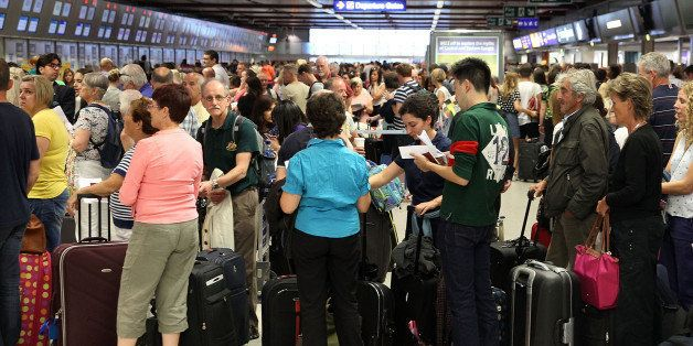 LUTON, ENGLAND - SEPTEMBER 08:  A view of the crowds of people waiting to get a flight at London Luton Airport after a 'suspect package' was found on September 8, 2014 in Luton, England. Bedfordshire Police said that a suspect package was destroyed in a controlled explosion which took place at 17:15 after which the airport re-opened  (Photo by Danny E. Martindale/Getty Images)
