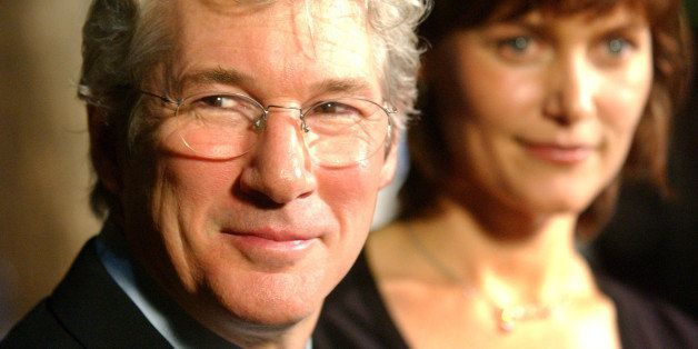 "Richard Gere, left, a cast member in the new film ""Chicago,"" and his wife Carey Lowell arrive at the premiere of the film in Beverly Hills, Calif., Tuesday, Dec. 10, 2002. (AP Photo/Chris Pizzello)"