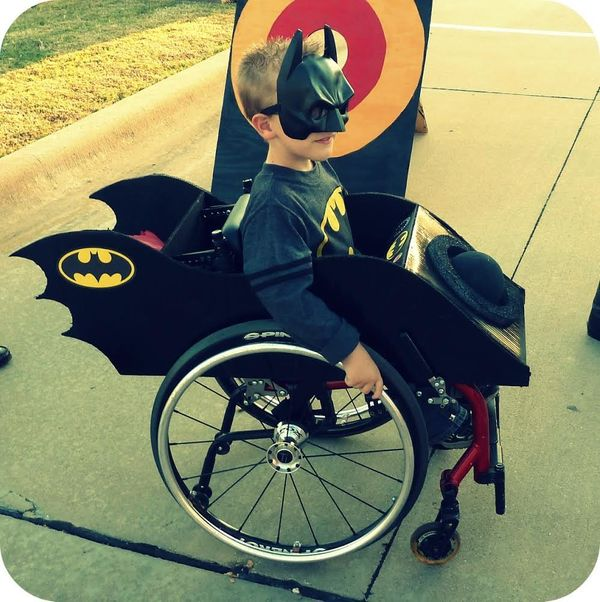 A 6-year-old Caleb dressed as Batman in his Batmobile for Halloween 2011.
