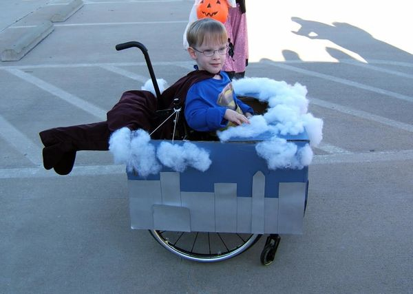 A 4-year-old Caleb dressed as Superman flying through the clouds​ during Halloween 2009.