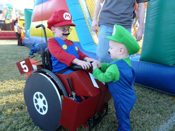 Caleb with his younger brother, who is dressed as Luigi.