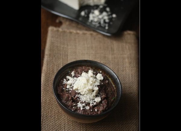 """Add a great kick to your tortilla chips with this black bean dip that is perfected with cotija cheese.   <a href=""""http://fe"""