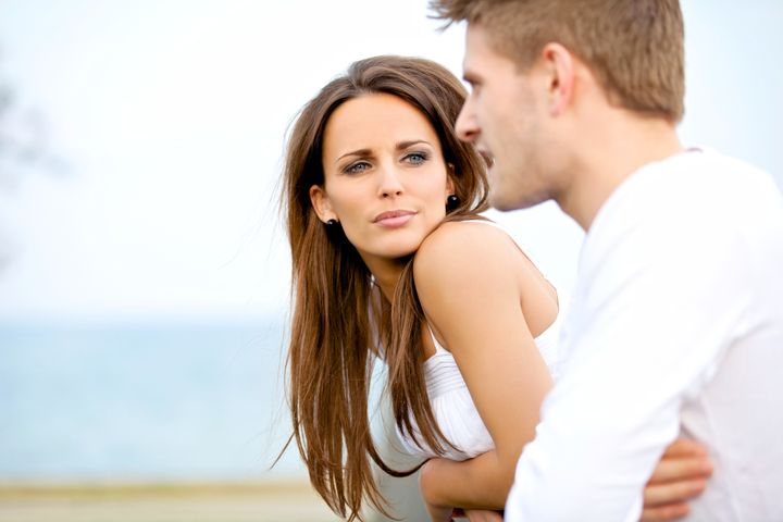 Portrait of an attractive woman seriously listening to her boyfriend while on a date