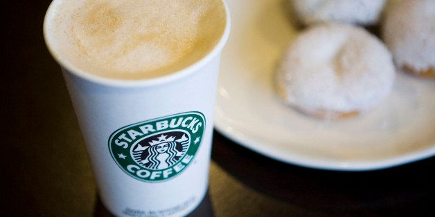 A Starbucks Corp. new low calorie vanilla latte and mini sparkle doughnuts are arranged for a photograph in New York, U.S., o