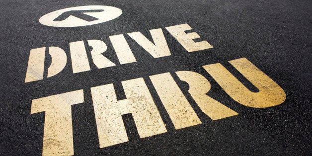 Drive Thru sign for fast food painted on asphalt