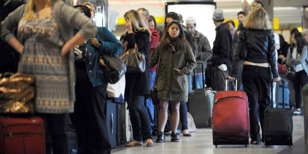 Travellers in a long check-in line caused by a computer malfunction at Spirit Airlines November 24, 2010 at La Guardia Airport in New York on what is considered the heaviest travel day of the year.  AFP PHOTO/Stan Honda (Photo credit should read STAN HONDA/AFP/Getty Images)