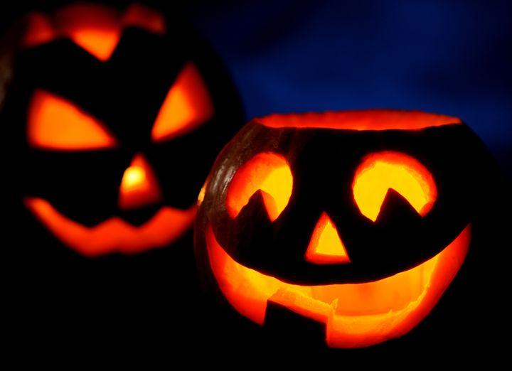 Scary halloween pumpkins jack-o-lantern on black background