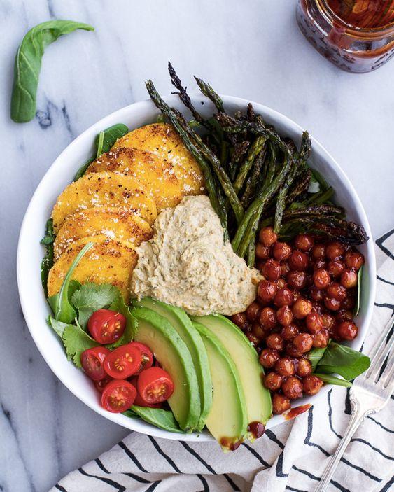 "<strong>Get the <a href=""http://www.halfbakedharvest.com/spicy-bbq-chickpea-crispy-polenta-bowls-asparagus-ranch-hummus/"" tar"