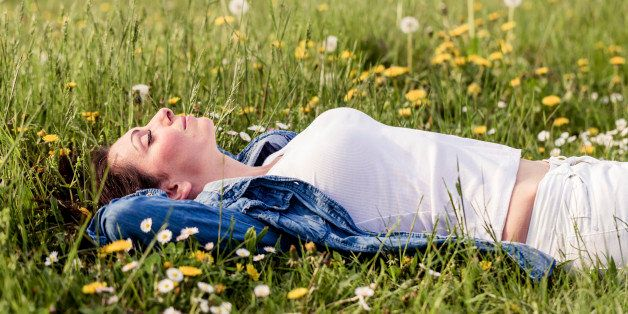 beautiful girl lying down on grass. Copy space.