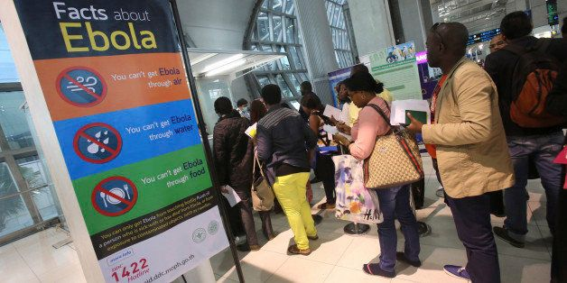Tourists queue up at Suvarnbhumi Airport to give their health record before leaving the airport in Bangkok Thailand  Monday, Oct . 27, 2014.  The longer the Ebola outbreak rages in West Africa, the greater chance a traveler infected with the virus touches down in an Asian city.(AP Photo/Sakchai Lalit)