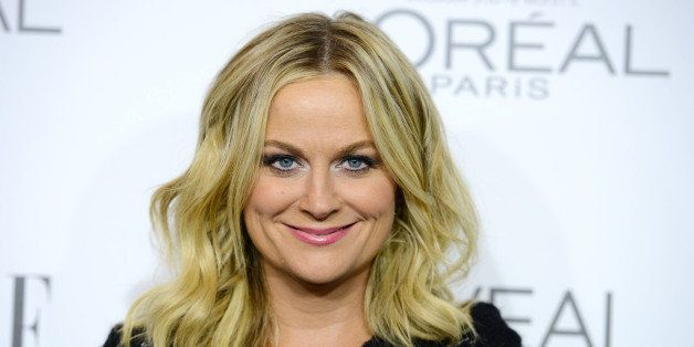 Amy Poehler arrives at ELLE's 21st annual Women In Hollywood Awards at the Four Season Hotel on Monday, Oct. 20, 2014, in Los Angeles. (Photo by Jordan Strauss/Invision/AP)