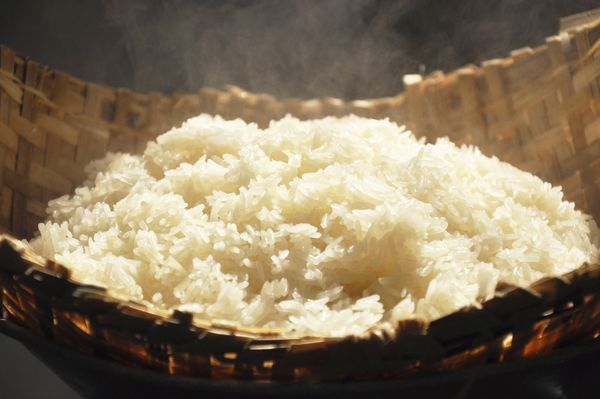 "Sticky rice <a href=""http://www.wisegeek.com/what-is-glutinous-rice.htm"" target=""_hplink"">requires less water</a> to cook tha"