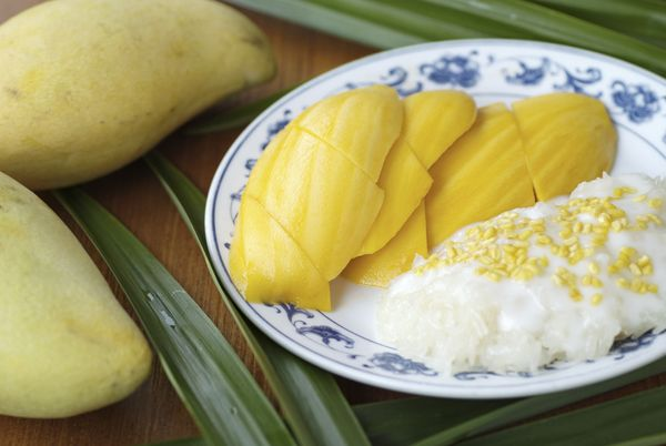 "Known as <a href=""http://www.foodnetwork.com/recipes/emeril-lagasse/sticky-rice-with-coconut-sauce-kha-niao-man-recipe.html"""