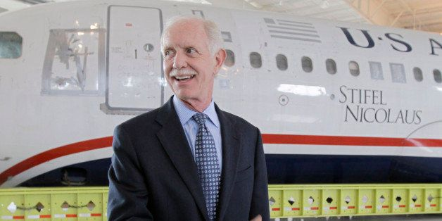 "Former Capt. Chesley ""Sully"" Sullenberger talks to the media in front of the US Airways flight 1549 aircraft at the Carolina Aviation Museum, Saturday, June 11, 2011, in Charlotte, N.C. The plane that made a miraculous landing on the Hudson River two years ago will be displayed in the museum in Charlotte. (AP Photo/Chuck Burton)"