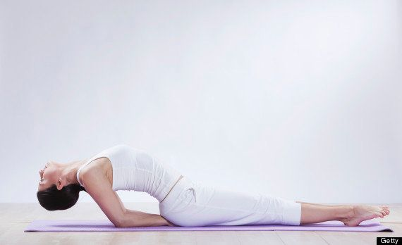 """The move pictured  is called """"fish pose"""" -- <a href=""""http://www.huffingtonpost.com/2013/09/22/yoga-in-bed_n_3950206.html"""" tar"""
