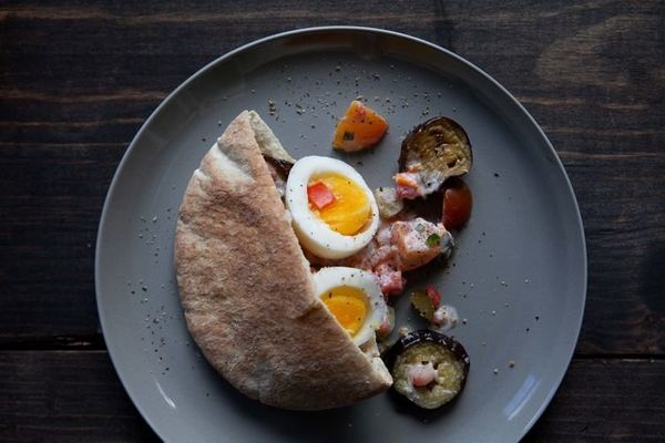 """<strong>Get the <a href=""""http://food52.com/recipes/31002-egg-and-eggplant-sandwich"""" target=""""_blank"""">Sabich recipe</a> from fi"""