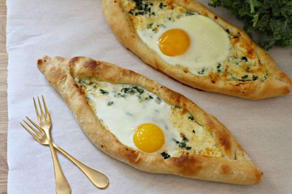 "<strong>Get the <a href=""http://whatjewwannaeat.com/kale-khachapuri-egg-cheese-bread/"" target=""_blank"">Kale Khachapuri recipe"