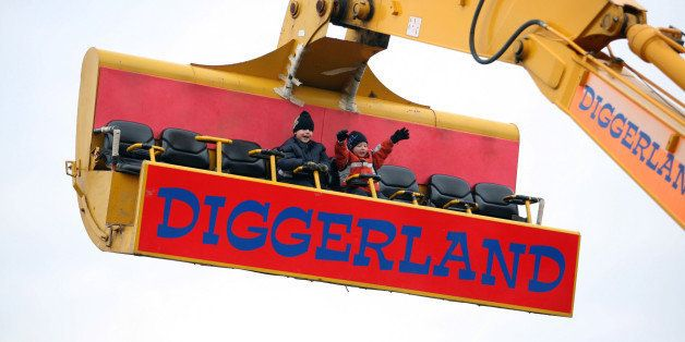 UNITED KINGDOM - DECEMBER 20:  Young visitors to Diggerland enjoy a ride on a spinning JCB arm, near Rochester in Kent,Tuesday, December 20, 2005. For children or adults, operating full-scale machinery, is the key attraction of the 24-acre dirt park, about an hour's drive south of London in Kent.  (Photo by Graham Barclay/Bloomberg via Getty Images)
