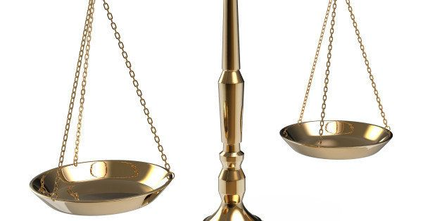 gold scales of justice isolated ...