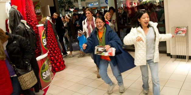 Shoppers enter a J.C. Penney store at 4 a.m. at Simon Property Group's Great Lakes Mall in Mentor, Ohio, U.S., on Friday, Nov. 26, 2010. Shoppers on Black Friday, the biggest shopping day of the year, are taking advantage of deals as they face down a slower economic recovery than projected. Photographer: Daniel Acker/Bloomberg via Getty Images