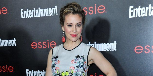 Alyssa Milano arrives at the Entertainment Weekly Screen Actors Guild Party at the Chateau Marmont on Friday, January. 17, 2014 in Los Angeles. (Photo by Richard Shotwell Invision/AP)