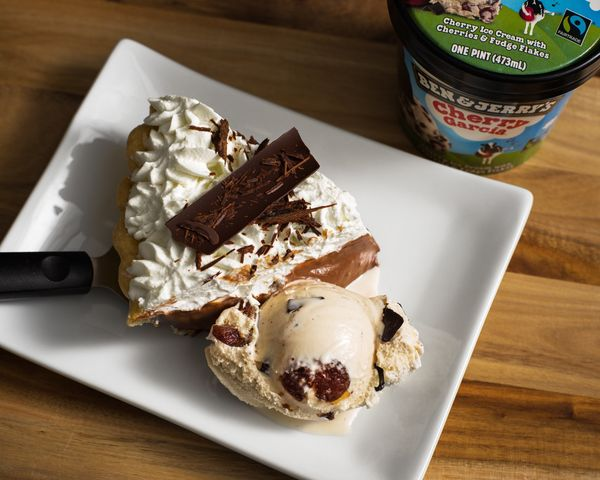 "Cherry Garcia is cherry ice cream with cherries and fudge flakes. According to Ben & Jerry's, ""this pairing is like a box of"