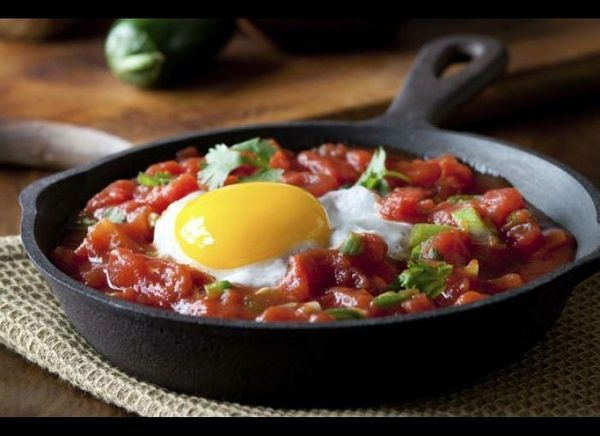 """The name literally means """"rancher's eggs,"""" but you don't have to be a farmhand to love fried eggs and tomato-chile sauce atop"""