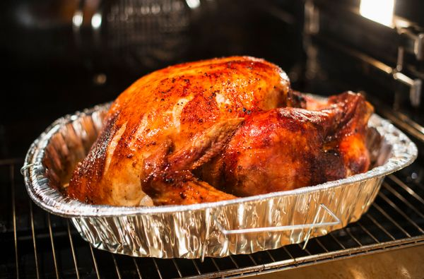 Yes, you can. And yes, this will make your Thanksgiving feel infinitely easier. Pop the bird in the oven the evening before a