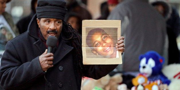 Activist Art McCoy holds a photo of Tamir Rice before a protest march at Cudell Park in Cleveland, Monday, Nov. 24, 2014. The