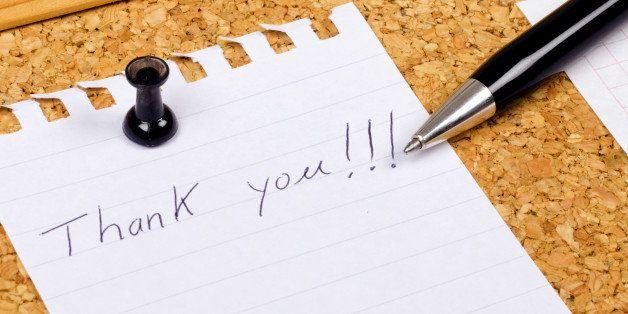 Yhank you note on a corkboard