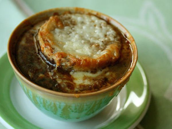 """<strong>Get the <a href=""""http://www.huffingtonpost.com/2011/10/27/french-onion-soup-with-gu_n_1061104.html"""">French Onion Soup"""