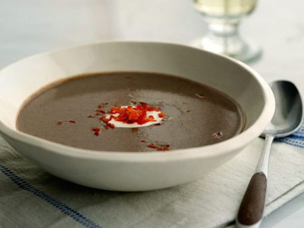 """<strong>Get the <a href=""""http://www.huffingtonpost.com/2011/10/27/spicy-black-bean-soup-wit_n_1057733.html"""">Spicy Black Bean"""