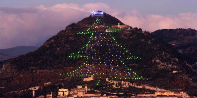 GUBBIO, ITALY:  A Christmass tree decorates Mount Ingino, overlooking the Umbrian city of Gubbio, 11 December 2006. The tree is 650 meters long with a surface area around 1,000 square meters and covered by more than 4000 lights.  AFP PHOTO / PAOLO TOSTI  (Photo credit should read Paolo TOSTI/AFP/Getty Images)