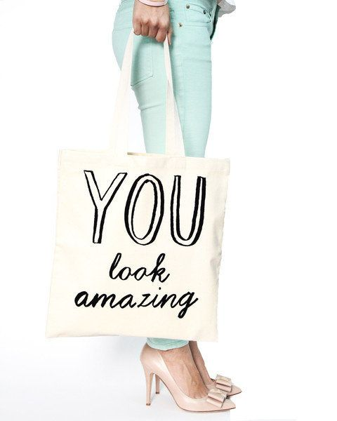 "<a href=""http://www.artsymodern.com/collections/bags-totes/products/you-look-amazing-tote-bag"" target=""_blank"">You Look Amazi"