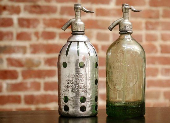 These colored, engraved seltzer bottles from Argentina date back to the early 20th century. They no longer work, but, boy, do