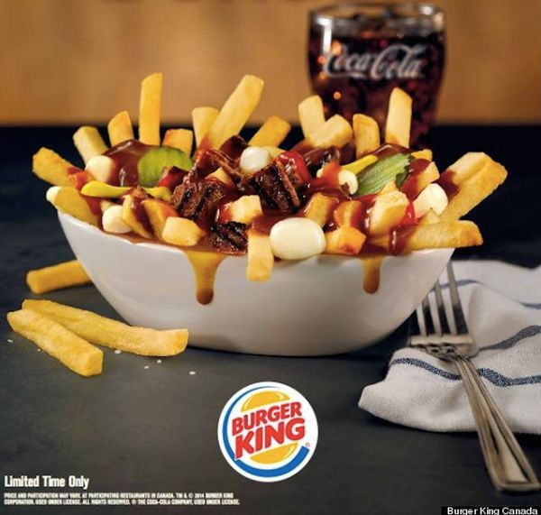 This is crude. Poutine is a staple comfort food in Canada. Fries are topped with gravy and a bit of cheese curds. Burger King