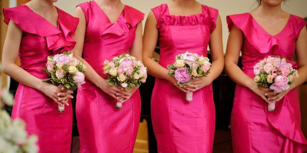 row of bridesmaids with...