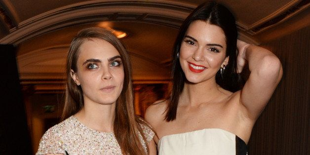 LONDON, ENGLAND - DECEMBER 01:  Kendall Jenner (R) and Model of the Year winner Cara Delevingne attend the British Fashion Awards at the London Coliseum on December 1, 2014 in London, England.  (Photo by David M. Benett/Getty Images)