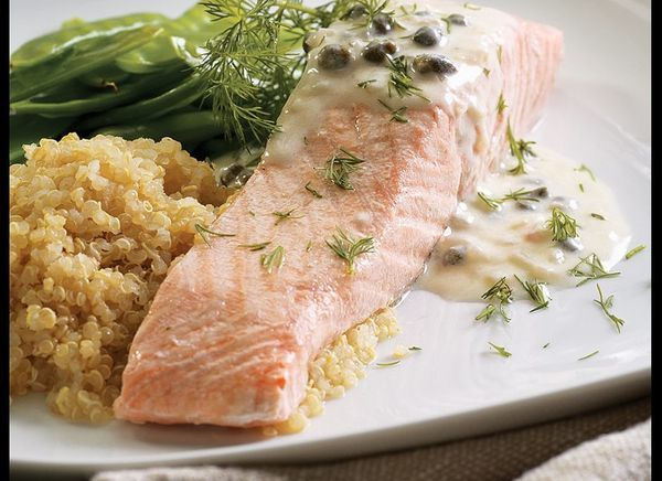 Poaching salmon is a light way to prepare this fatty fish. Topping it with the creamy piccata sauce -- full of capers, shallo