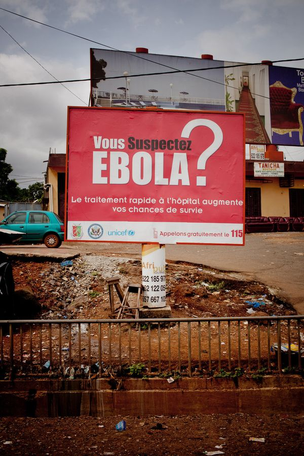 """A prevention poster in Conakry. The government's delay in responding to the crisis and the 24 billion Guinean francs in cuts"