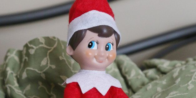 Elf on a Shelf gets comfortable in the guest room.