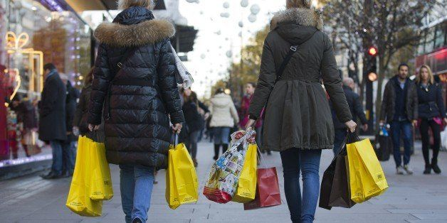 People walk along Oxford Street with carrier bags full of shopping in central London on December 8, 2014. AFP PHOTO/JUSTIN TALLIS        (Photo credit should read JUSTIN TALLIS/AFP/Getty Images)