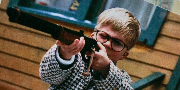 A photo of the character Ralphie, played by actor Peter Billigsley,  firing his Red Ryder air rifle from the classic movie 'A Christmas Story'  is seen in the back yard of the house used in the filming of the movie in Cleveland, Monday, Nov. 13, 2006.  Brian Jones, who had started a business selling the leg lamp made famous in the film, has bought the house and has renovated it as a museum. (AP Photo/Amy Sancetta)
