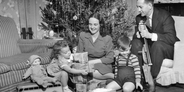 UNITED STATES - CIRCA 1950s:  Family sitting in front of Christmas tree.  (Photo by George Marks/Retrofile/Getty Images)