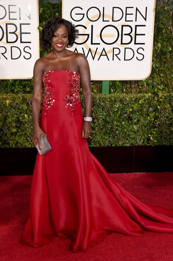 Davis looked regal in red and stole the show in this statement-making dress. Not only did the color pop, but the embellishmen