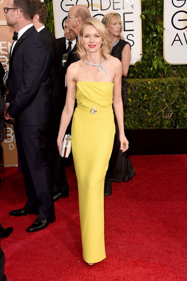 The star wore yet another yellow strapless dress we adore. The ruched bodice and belt draw attention to her most narrow part,