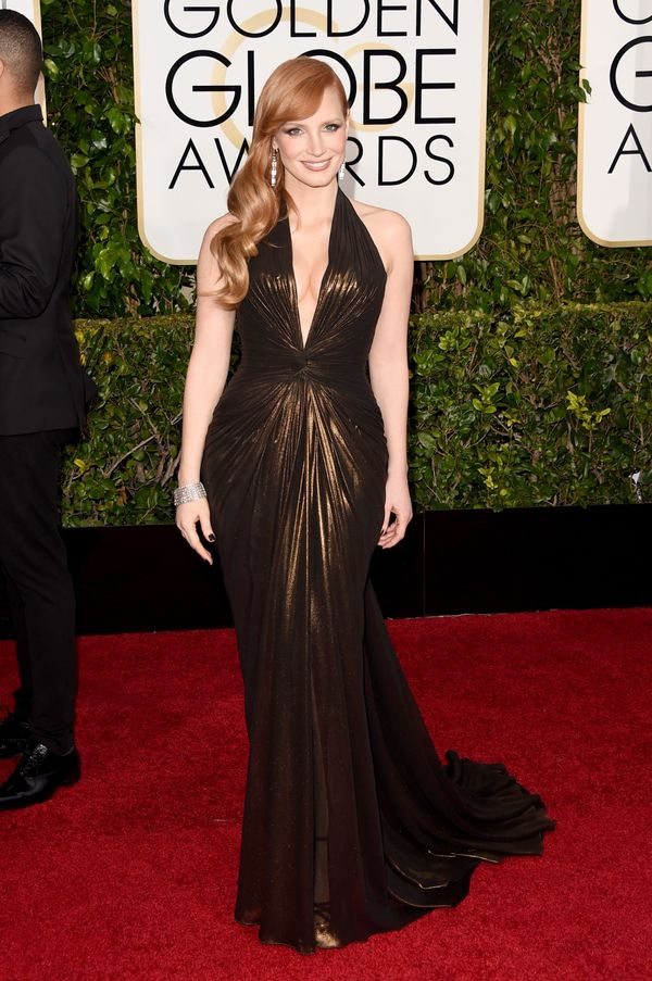 Woah, this is one sexy look. The plunging neckline on this gown, combined with the color, made Chastain look like a goddess.
