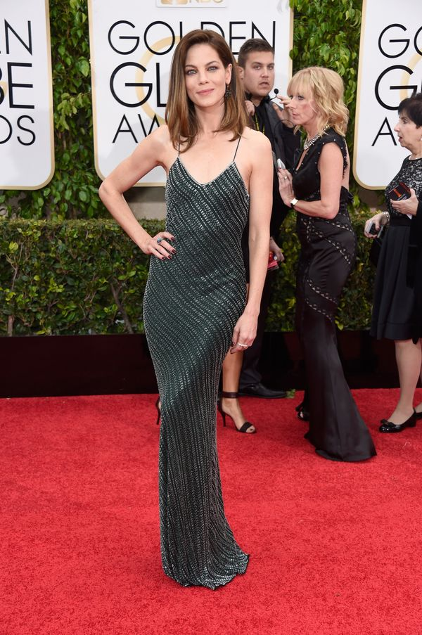 Not everyone could pull off this unforgiving dress, but Monaghan's body was made to wear it. The rich emerald color pops agai