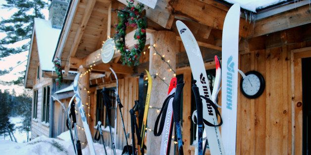 This December 2012 photo shows cross-country skis left by guests outside the Appalachian Mountain Clubs Gorman Chairback Lodge, a backcountry wilderness lodge near Greenville, Maine. In winter, visitors can reach the lodges and cabins only by cross-country skiing in. (AP Photo/Lynn Dombek)